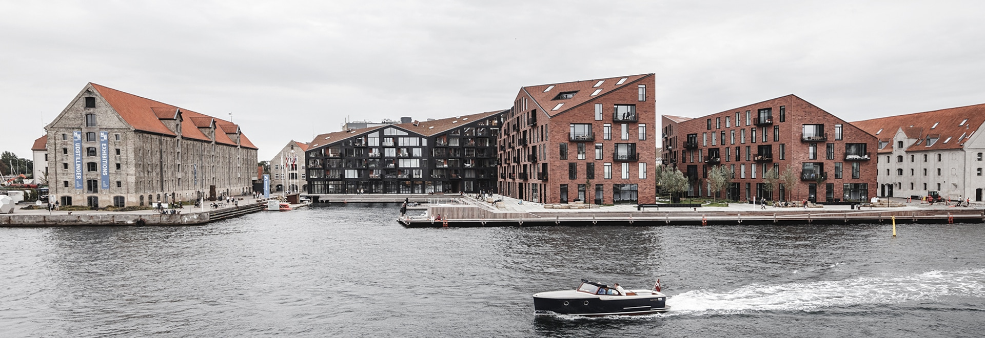 COBE + vilhelm lauritzen mimics existing warehouses in copenhagen housing project