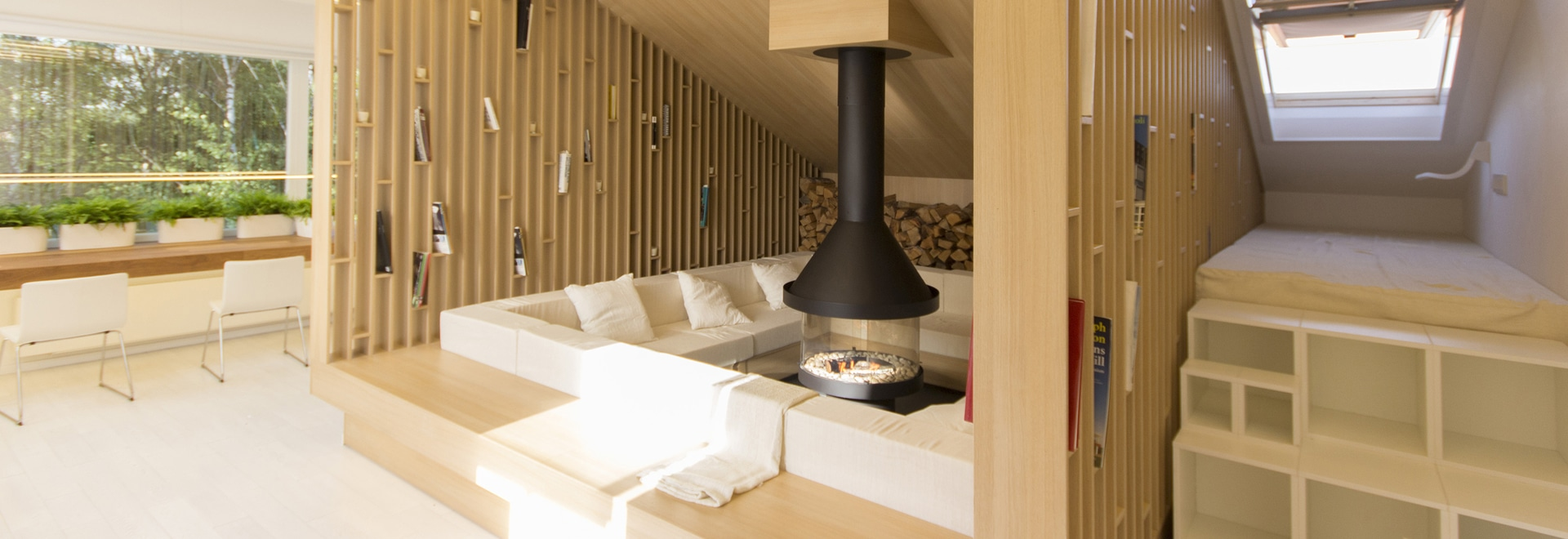 A Comfortable Lounge With Open Shelving Surrounds A Fireplace In This Home