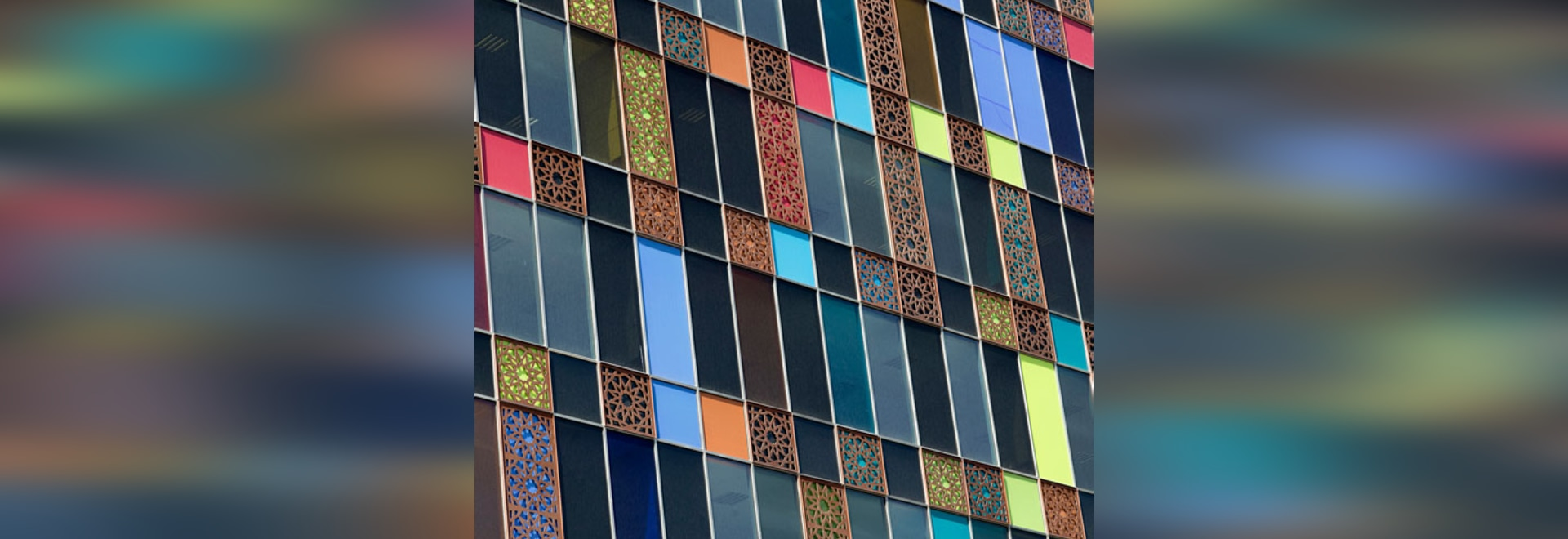 The decorative, polychrome exterior of industrial glass company Kaveh's Tehran office, which was completed in 2015, also broadcasts what the firm manufactures