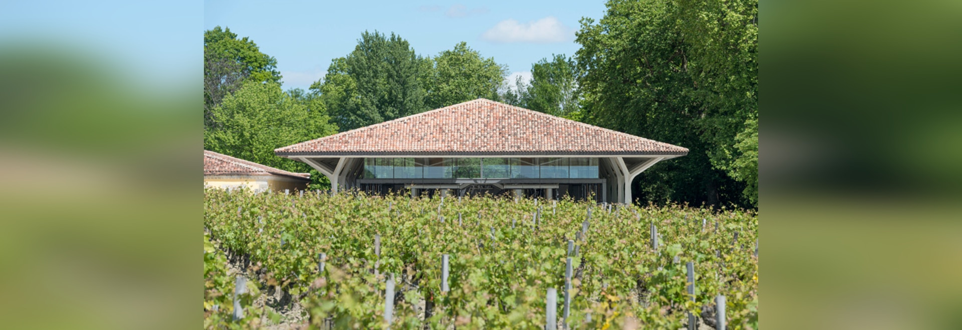 the design reinterprets the region's vernacular style of tiled roofs