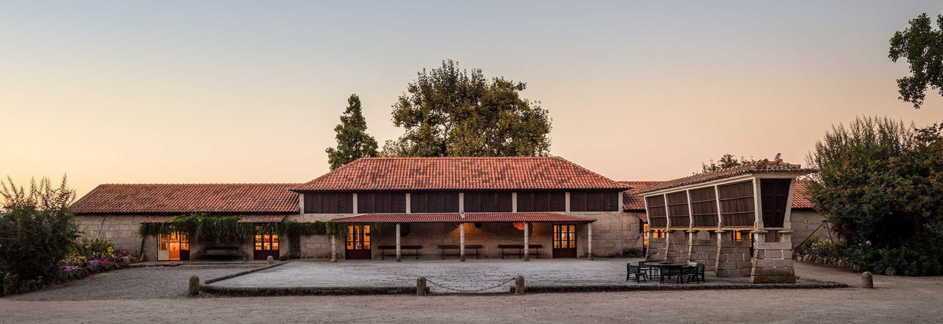 diogo aguiar studio converts disused barn into winery in pastoral northern portugal