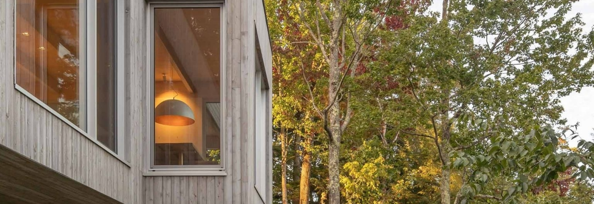 A House In The Forest Clad In Eastern Cedar Siding Is Raised Above The Surrounding Rocky Landscape
