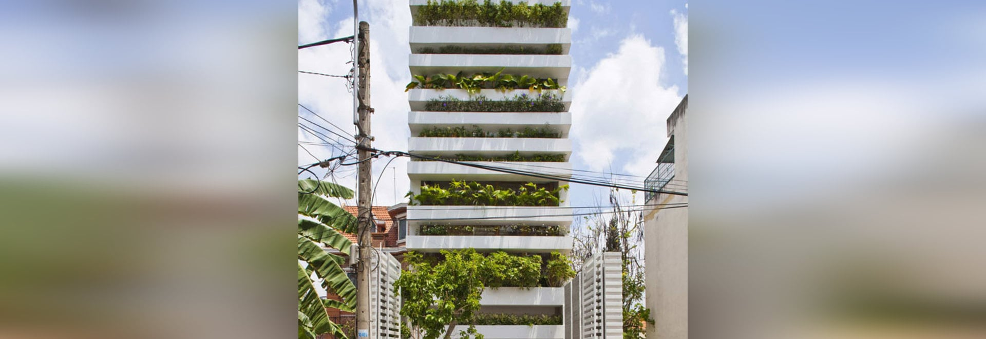 The hung planters forming the facade of a detached house by Vo Trong Nghia in Ho Chi Minh City allow variations in plant height and type. The plants are watered automatically by means of an integra...
