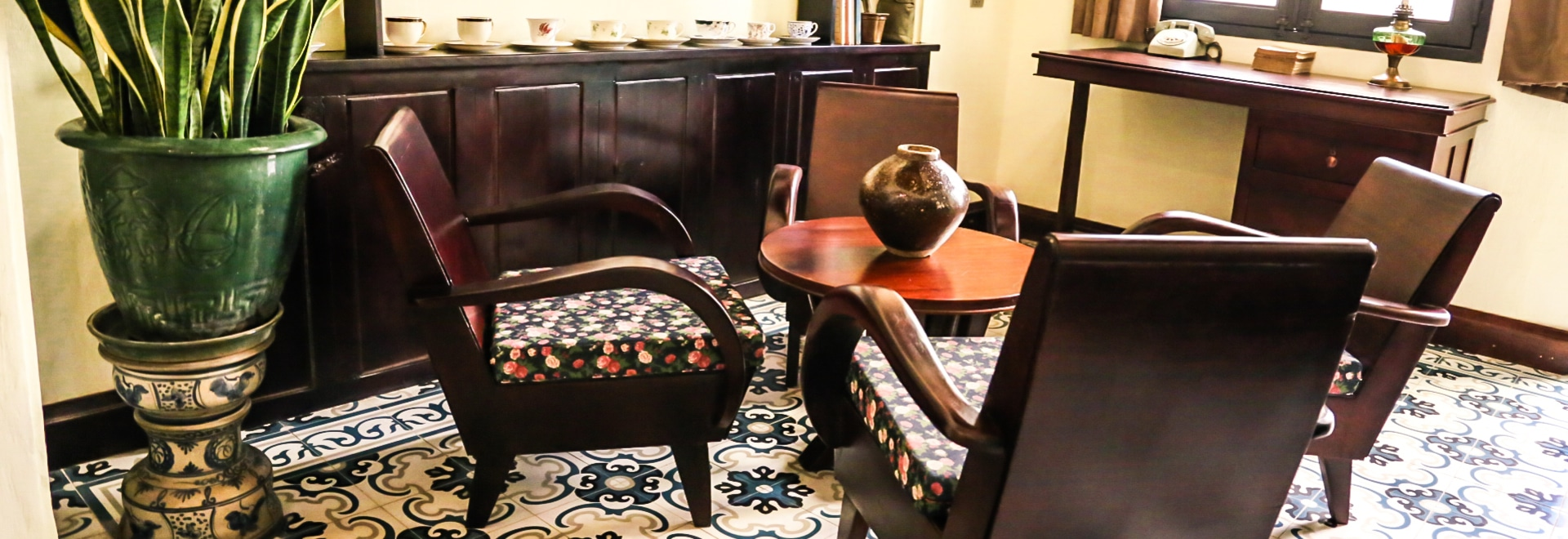 Indochine decor with wooden furniture and handmade cement tile