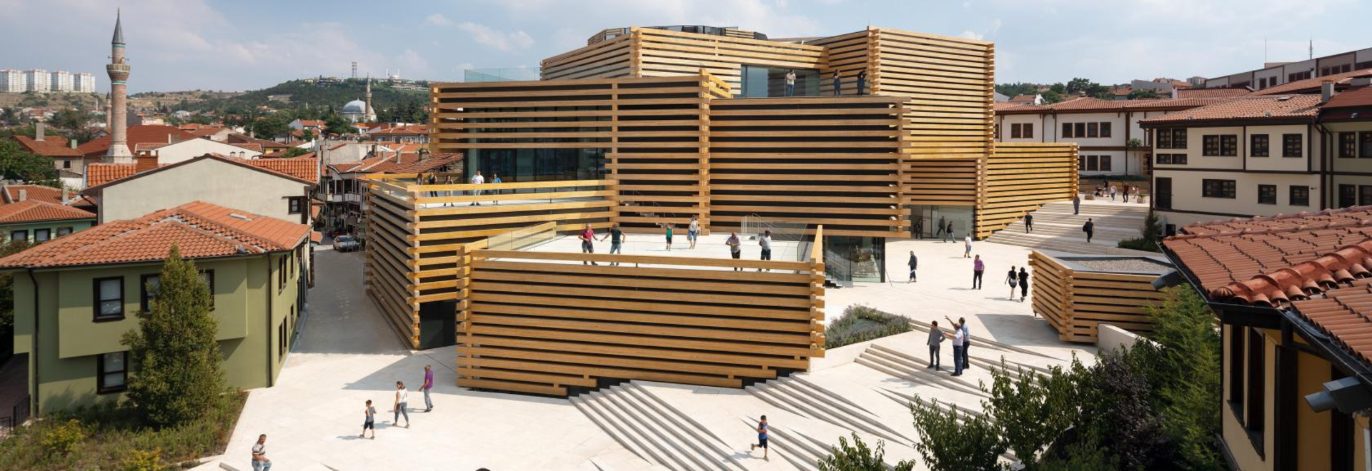 Kengo Kuma's stacked timber structure for the OMM museum in Turkey opens to the public this September. Photography: NAARO
