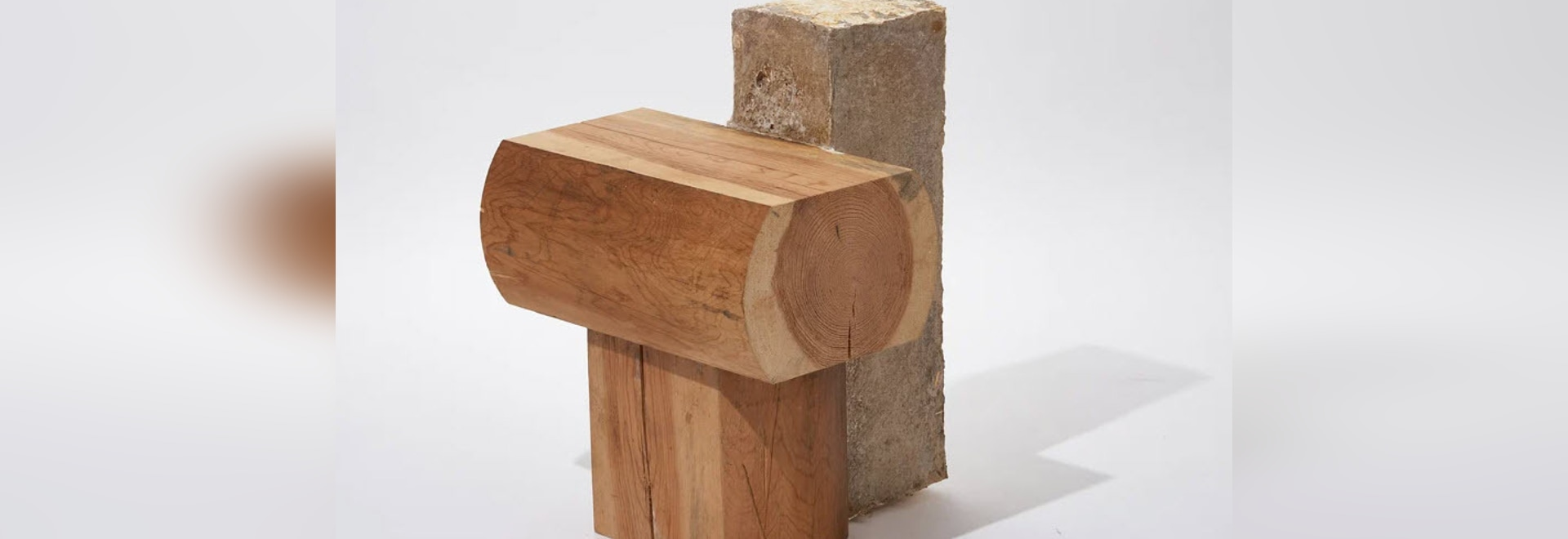 Kyunchul Kim combines old construction wood with mycelium to create stool furniture