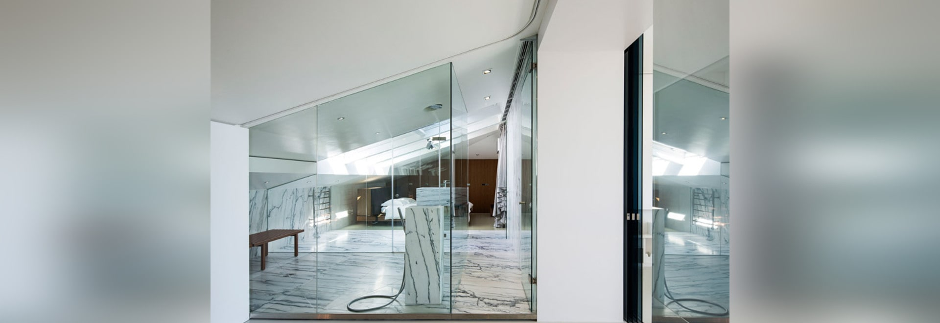 Lisbon apartment extended by Camarim Arquitectos to include an attic steam room