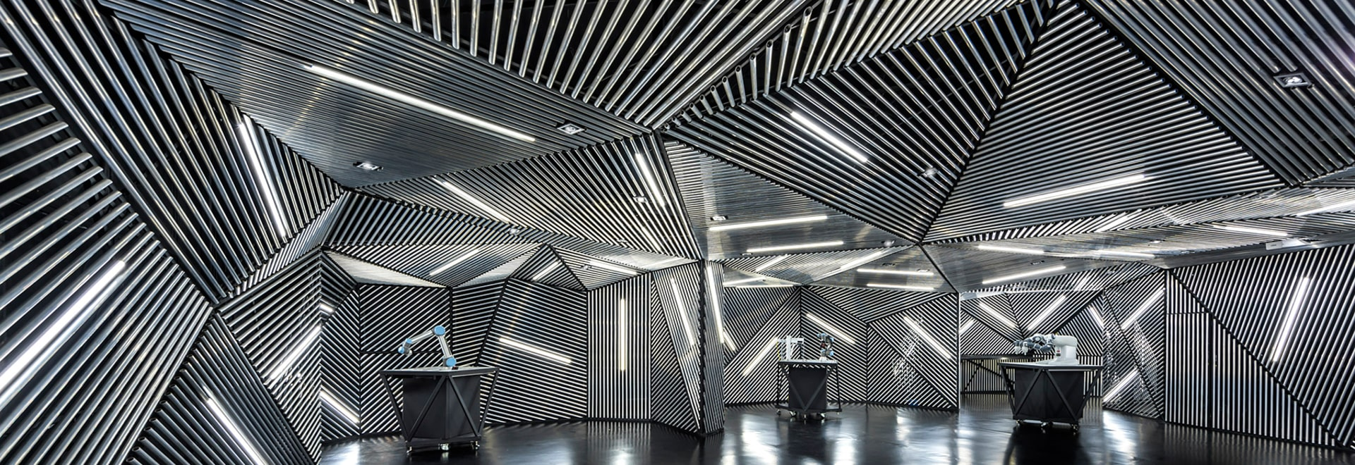 ministry of design's robotic facility in singapore features a hypnotic metallic skin