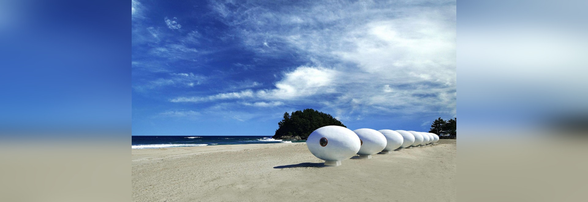 Mobile egg-shaped beach huts installed along a South Korean shoreline