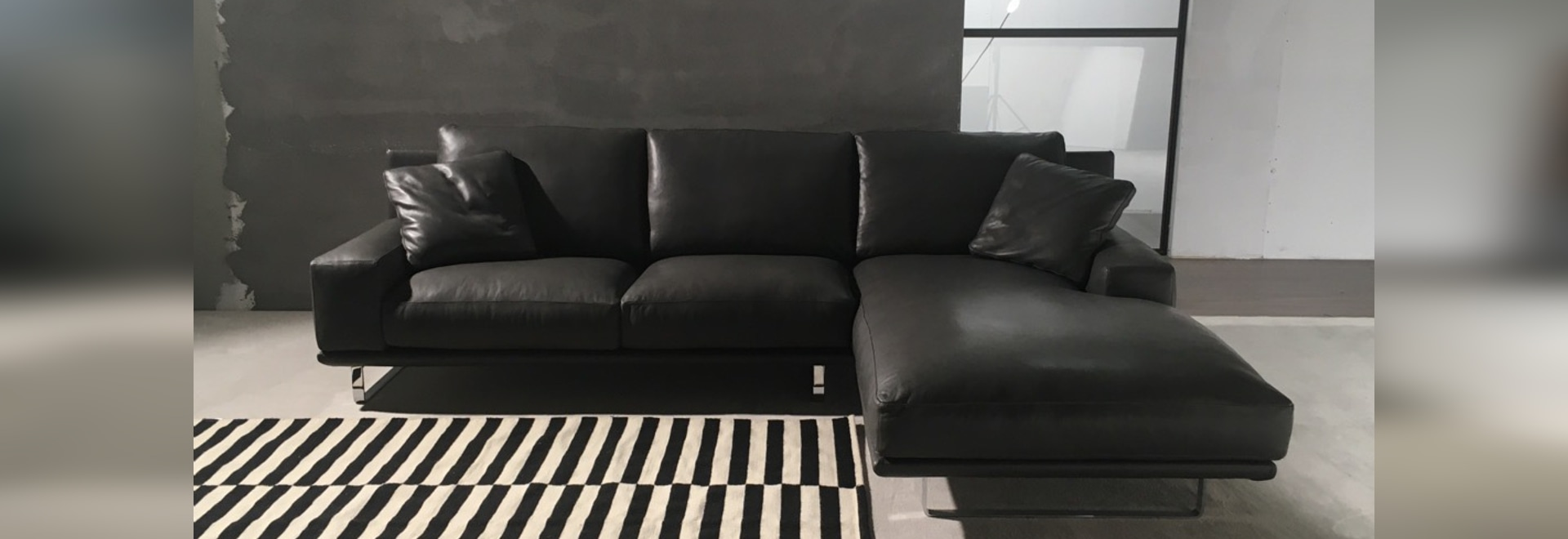 Modern leather sofa with chaise longue