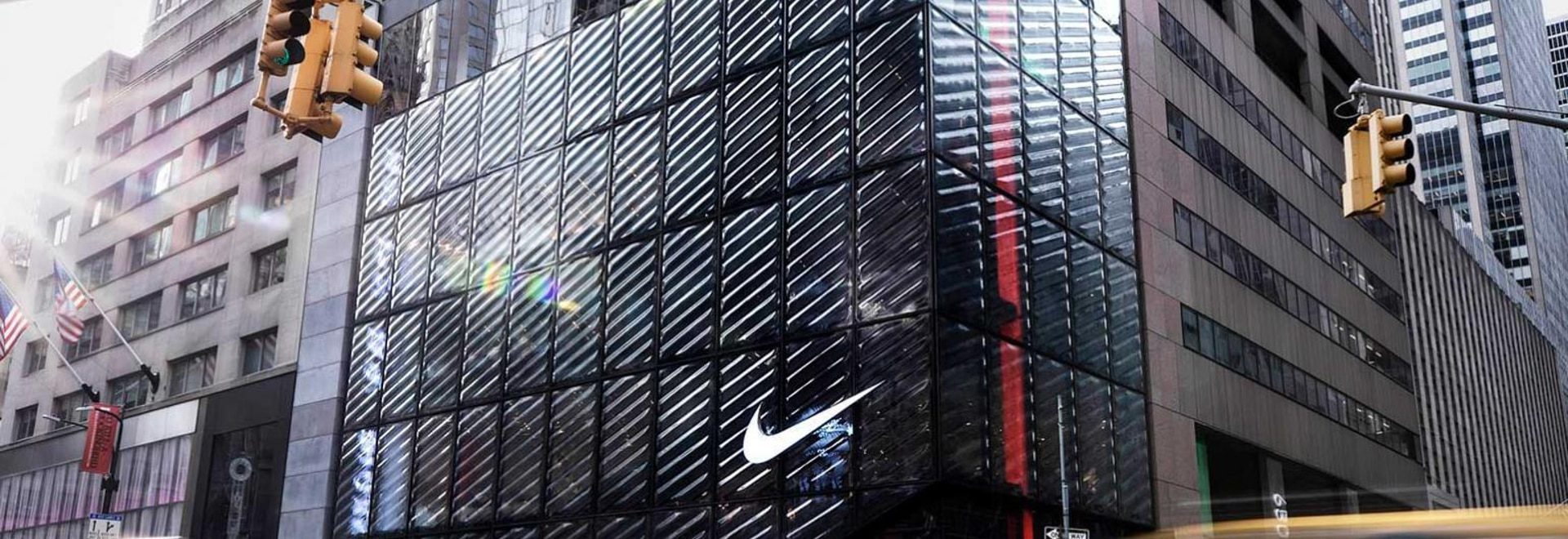 The Nike House of Innovation 000 features a façade, made from slumped and carved glass that bestows a kinetic effect.