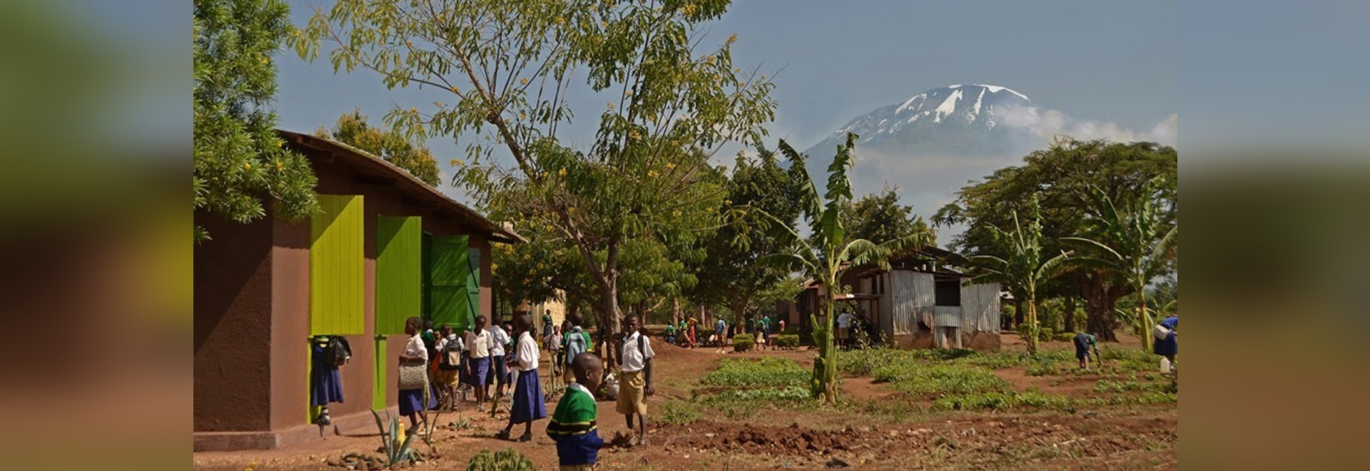 Off-grid Njoro Children's Library in Tanzania keeps naturally cool with compressed earth