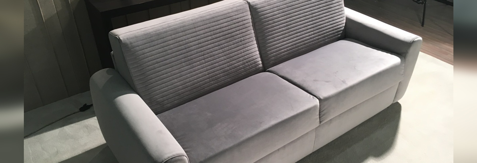 Philip sofa bed characterized by high seats and rounded armrests