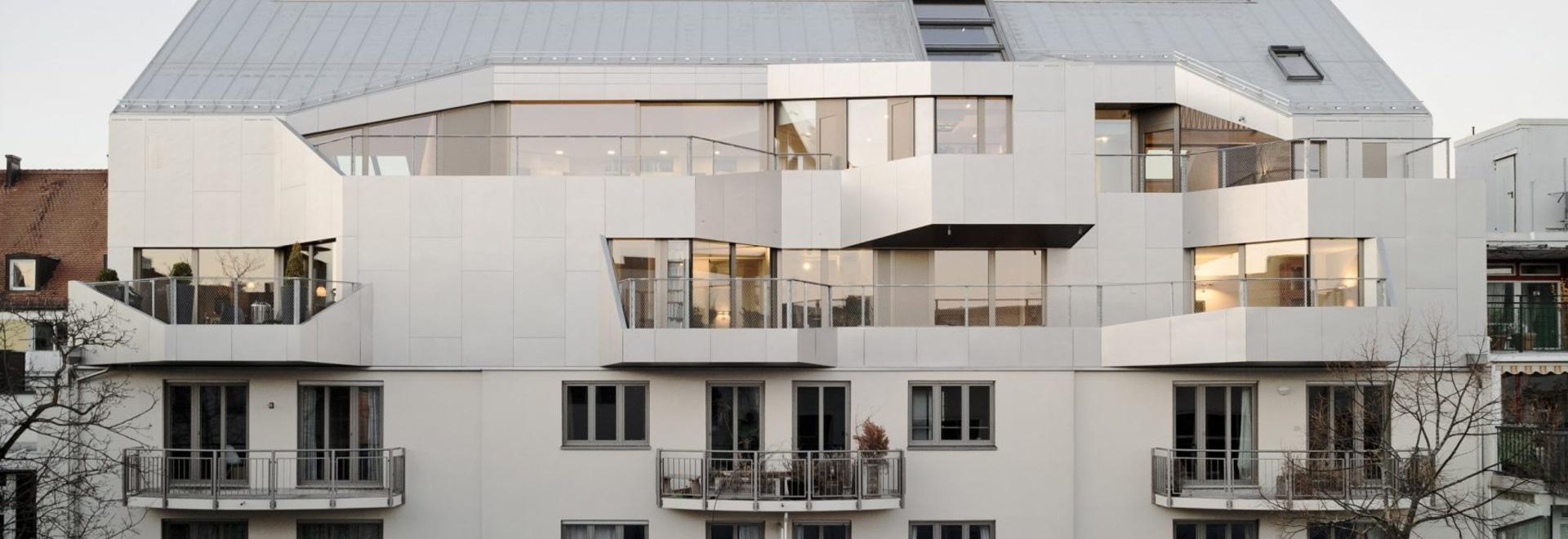 Pool Leber Architekten swaps concrete for wood to create R11 loft extension