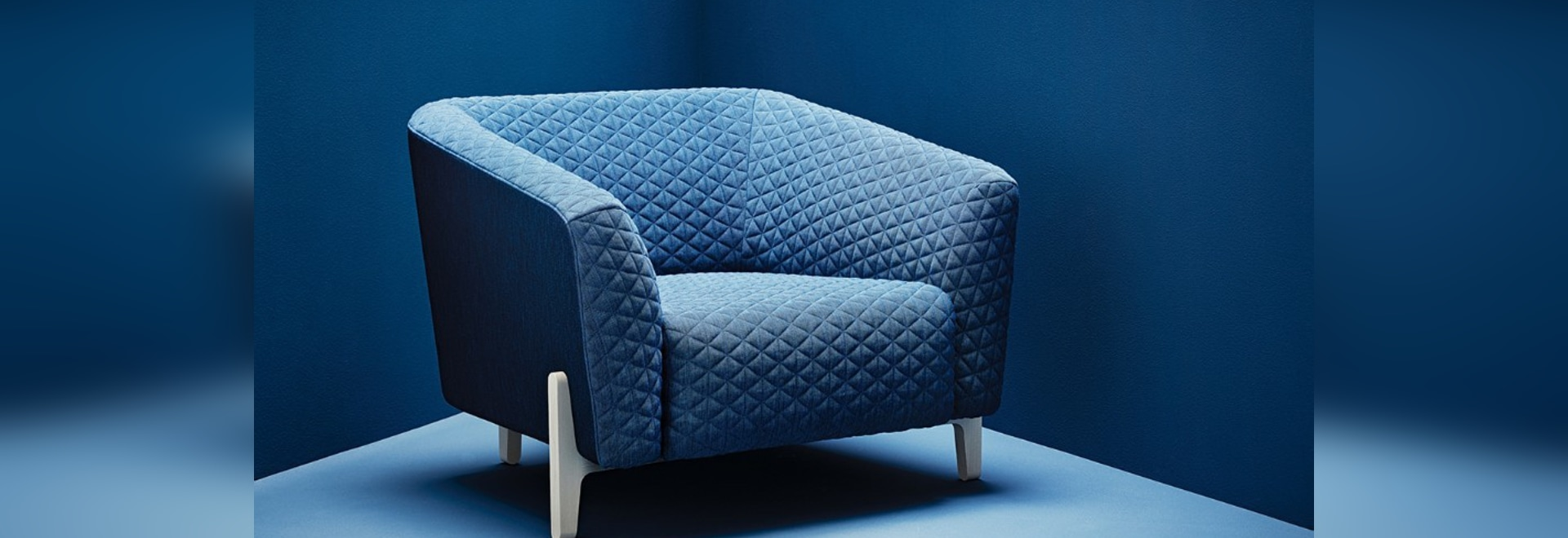 Quilted textiles cover modern seatings