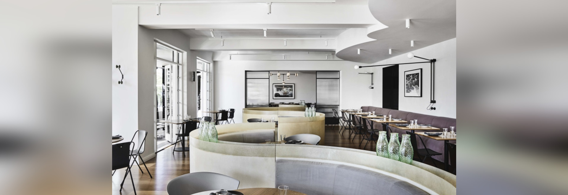 Referencing the geometry of the late Art Deco period, the S-shaped banquette helps zone the large open dining space, giving patrons a variety of seating options as well as privacy.