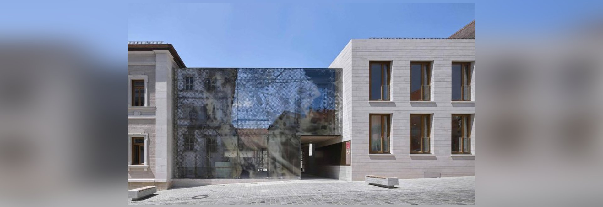 reiner john links historic building to new extension with glass façade
