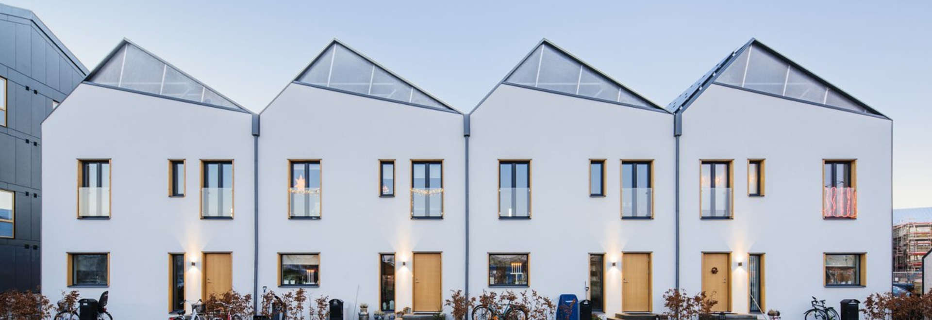 A row of homes facing east-west is topped with a sawtooth roofline. Each home's pitch is angled to catch as much sun as possible.