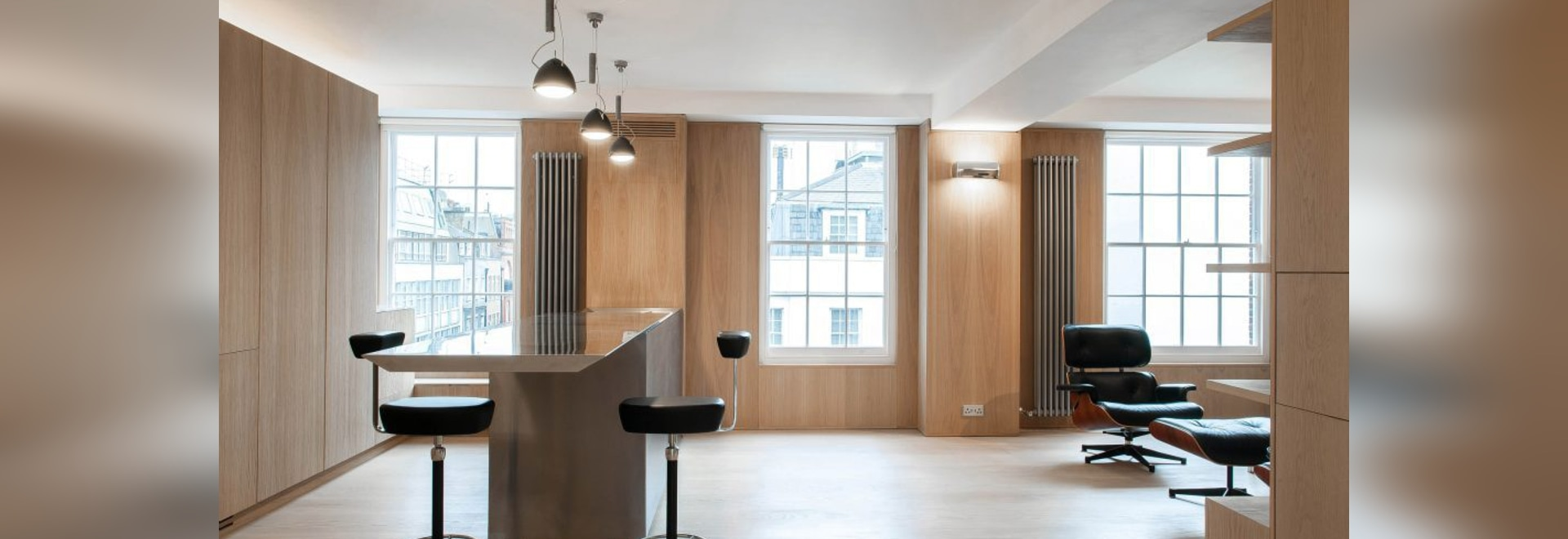 SIRS lines renovated London apartment in panels of marble and oak