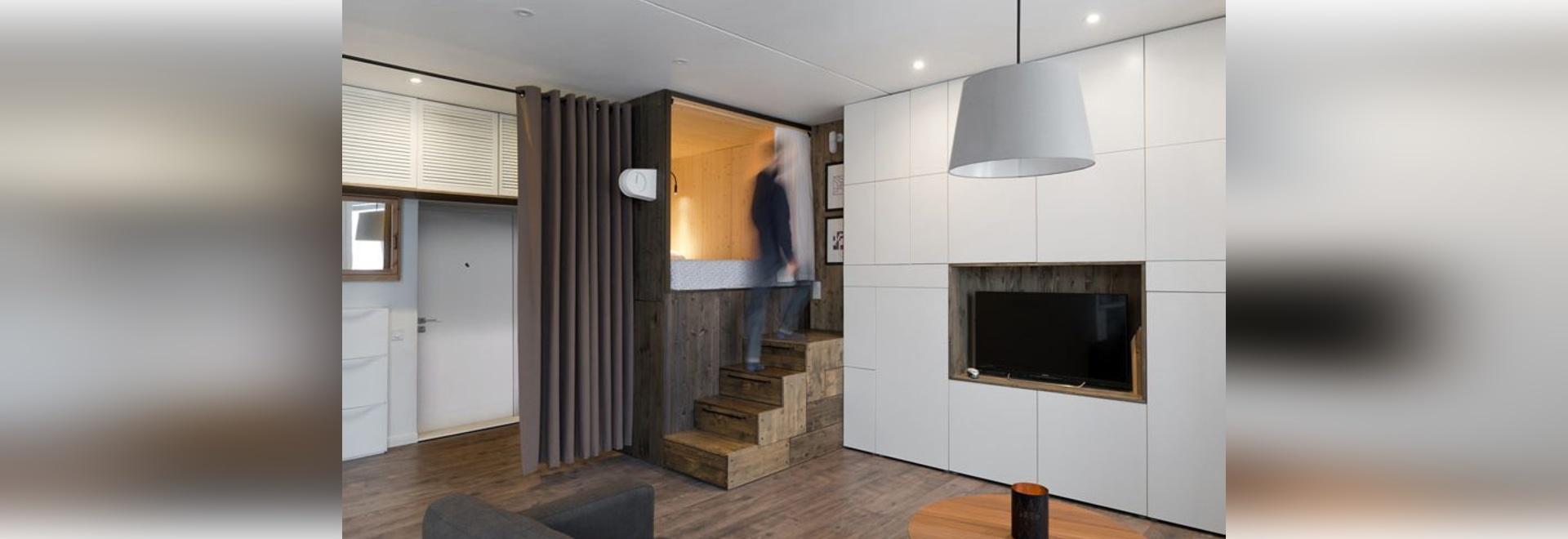 Small Apartment Design Idea – Raised bedroom allows for ...