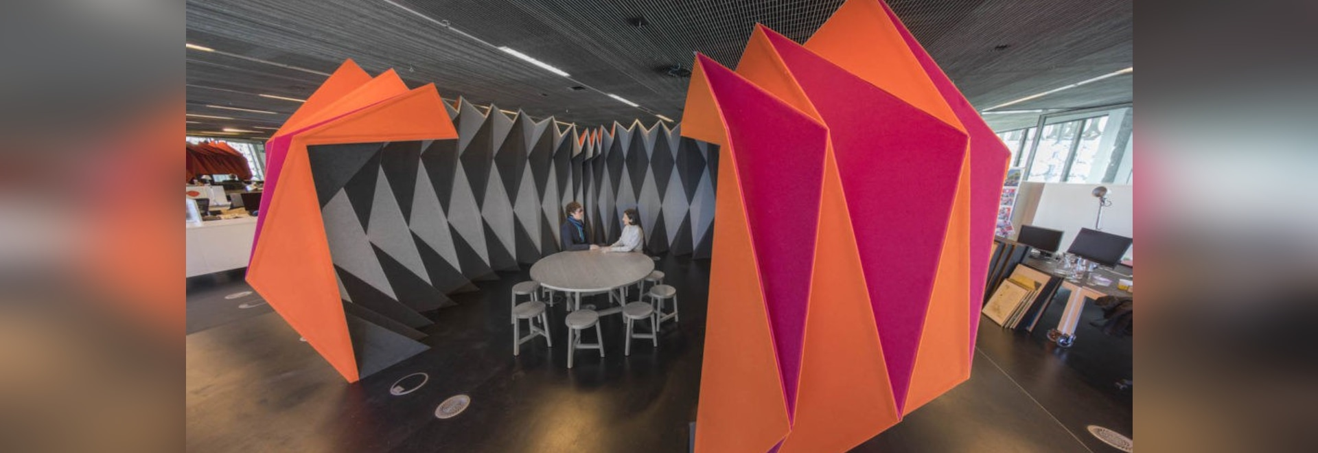 Sound-absorbing materials fold into a giant origami-like meeting pod