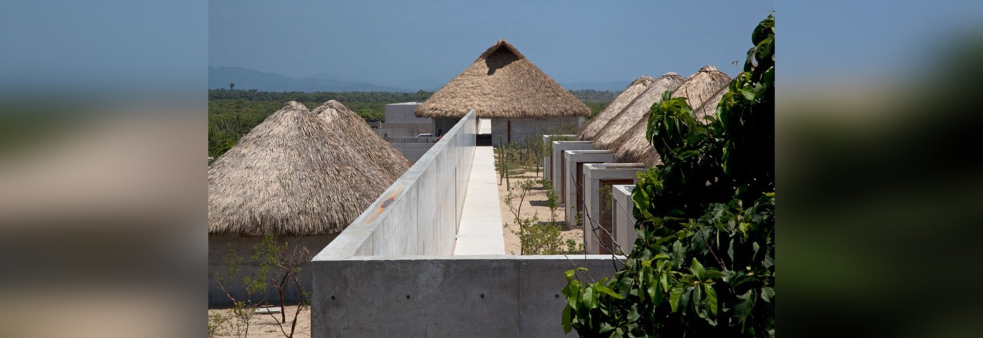 thatched roofs sit atop concrete huts