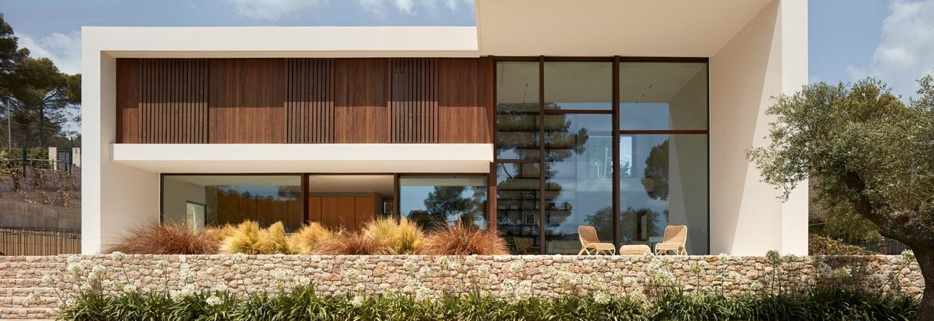 Thick Concrete Walls Give This New Home A Strong Presence