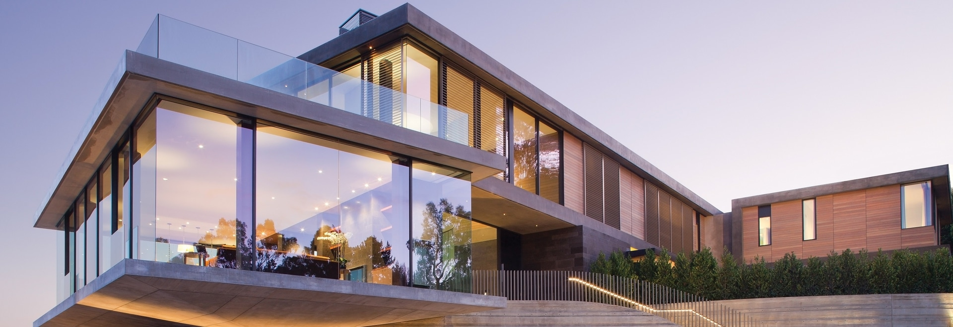 This House Has A Cantilevered Dining Room With Walls Of Glass