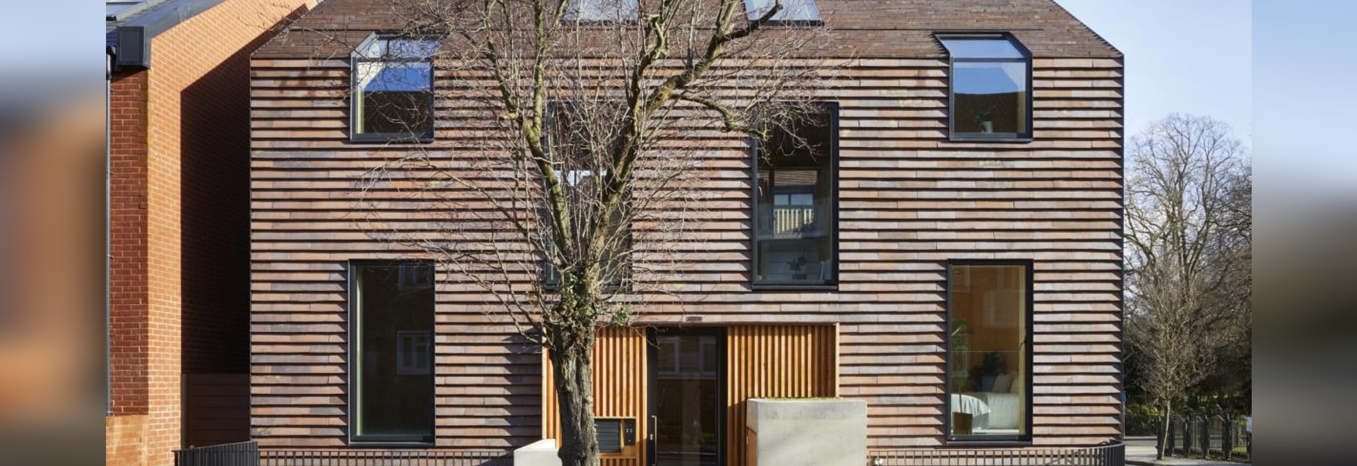 This modern apartment compex comprises ten shingle-clad units opposite Peckham Rye Park in South London