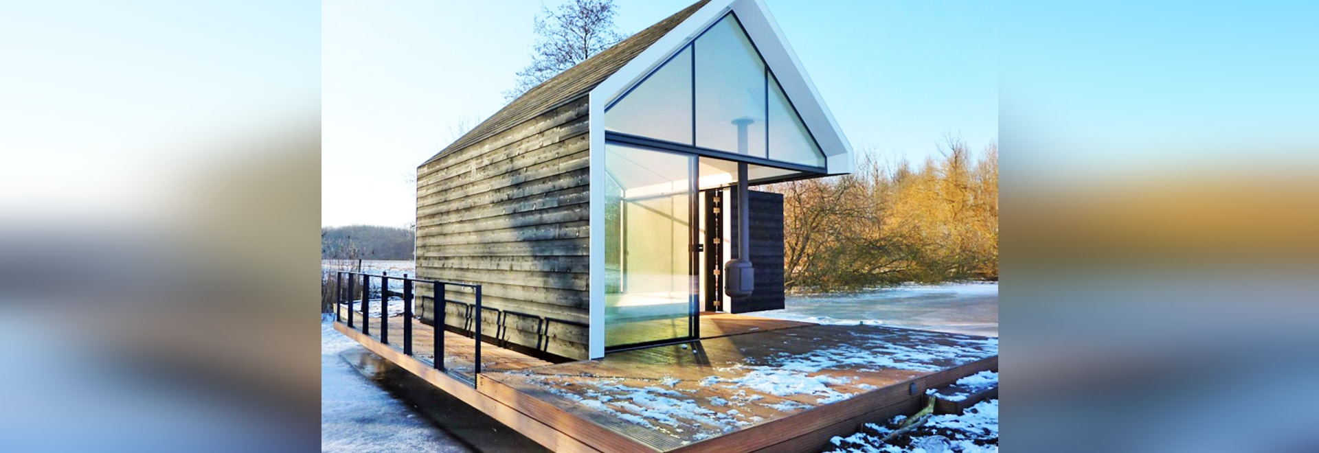 Tiny Glass and Timber Cabin Cleverly Folds Open to Blend in With the Dutch Landscape