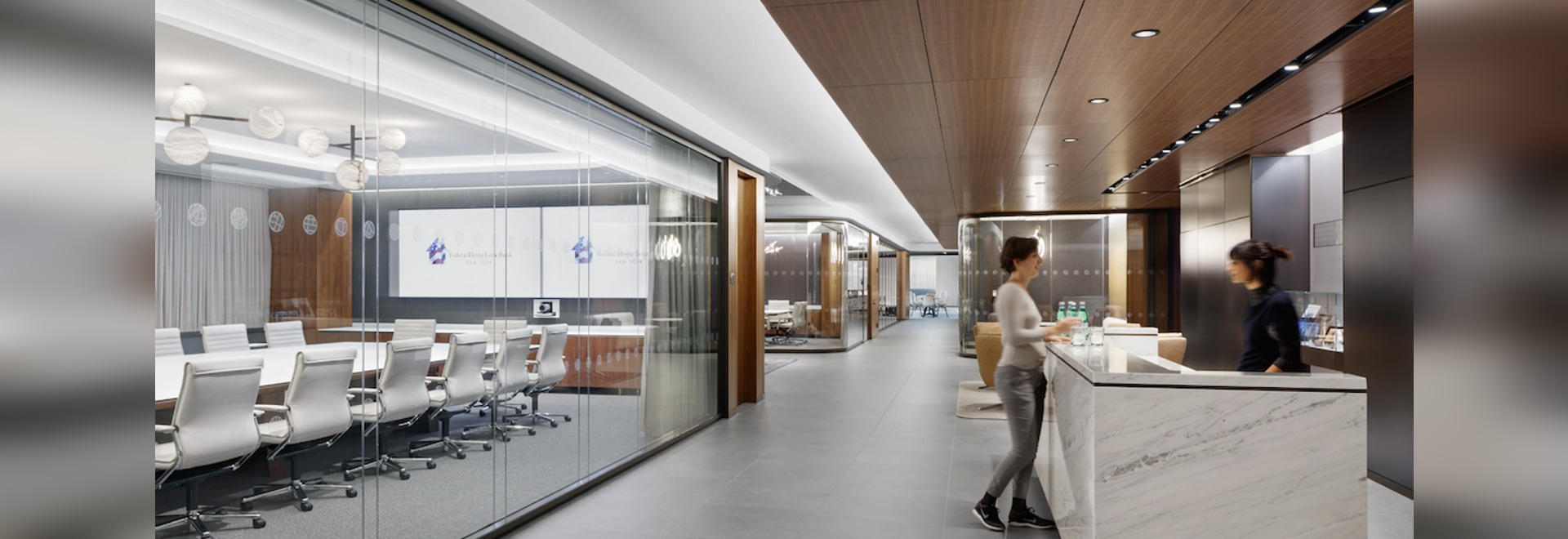 The walnut ceiling creates a warm atmosphere for visitors to the reception area. Photo: Colin Miller