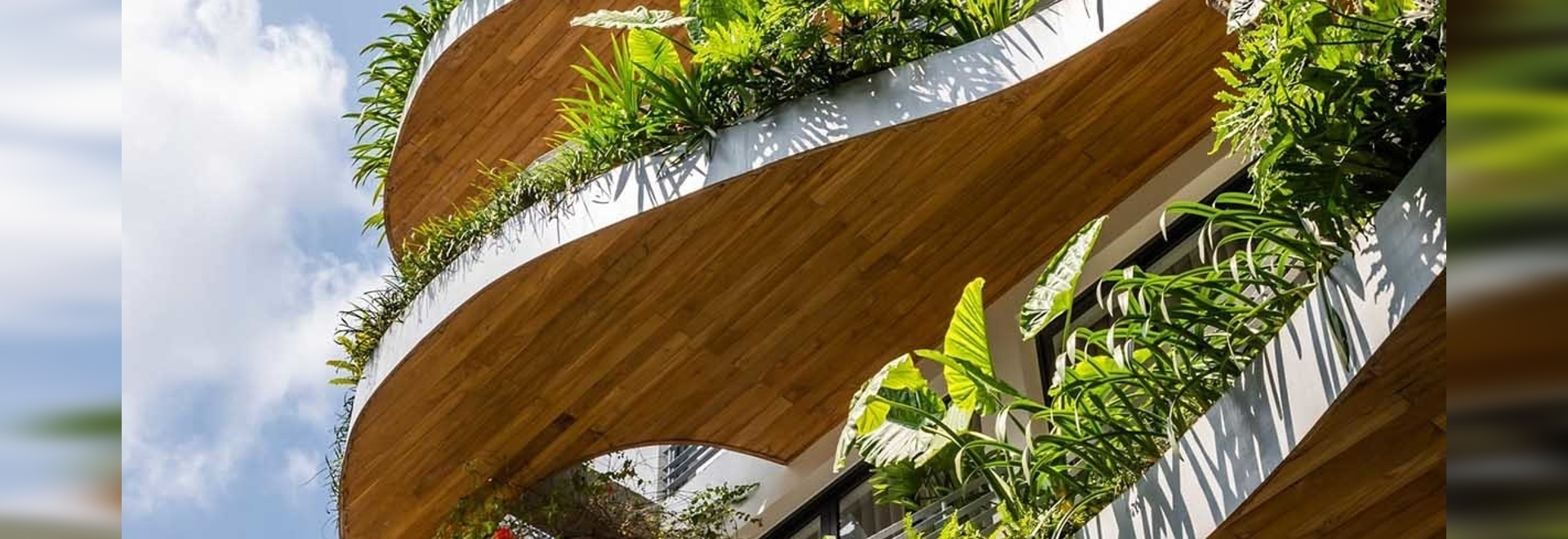 Wavy Balconies With Overhanging Plants Are A Design Feature On This Apartment Building