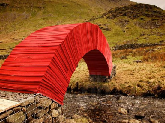 A WEIGHT-BEARING BRIDGE MADE FROM 20,000 SHEETS OF PAPER