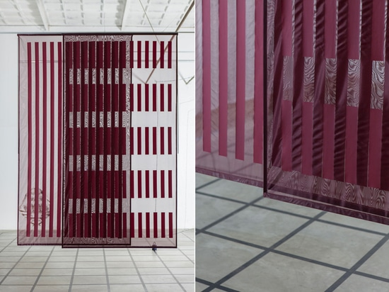 From afar, the Interline Panels by Raw Color look deceptively like glass panels but they are made of translucent textile and opaque foil with adjustable transparency.