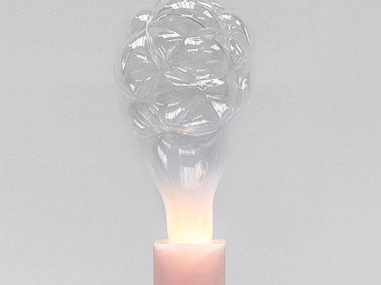 detail of the newa solid pink onyx column. S.M.O.K.E lamp presented during design miami/