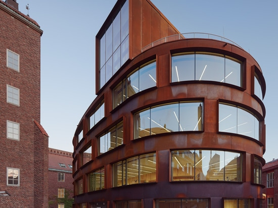 Tham & Videgård's Stockholm architecture school features a curving skin of pre-rusted steel