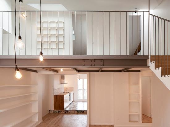 Cairos Architecture uses mezzanine level to create more room inside Paris apartment