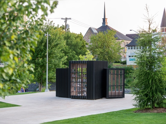 Atelier Kastelic Buffey creates miniature book exchange that folds up into a glowing black box