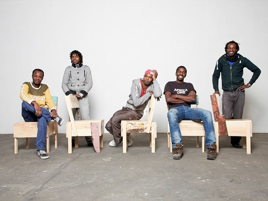Five refugees from the CUCULA programme with their limited-edition versions of the furniture