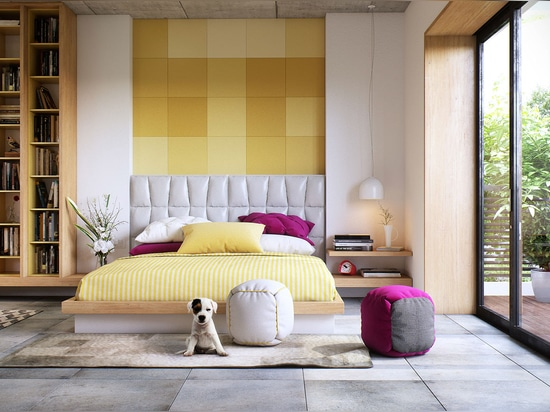 This bright and spacious room channels its playful style through a clever tile mosaic. In this case, the textured accent wall helps extend the short headboard for an integrated floor-to-ceiling eff...