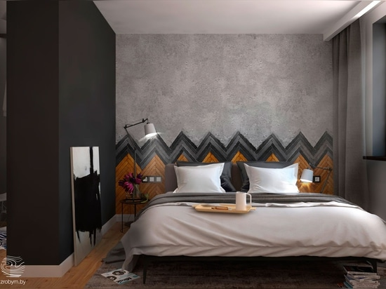 Wood and tile herringbone sets the backdrop for this dark, comfortable bedroom. Matte black paint opposite the window is an ingenious way to cut ambient light – perfect for people who like to sleep...