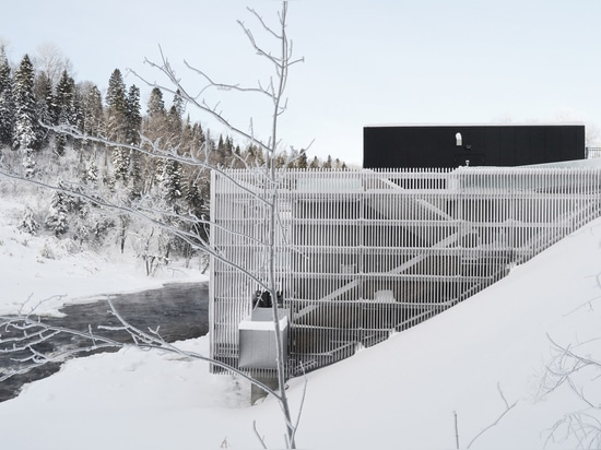 Timber-clad walkway wraps Quebec hydroelectric plant by Atelier Pierre Thibault