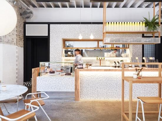 Matt Woods adds teabag chandelier and balancing bowls to Australian cafe