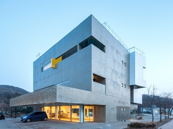 Maxcube by Studio Koossino houses creative workspaces within concrete walls