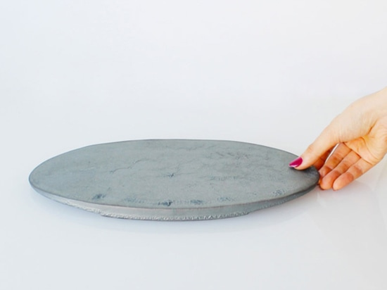 a 'reductional firing' technique burns the tiles at a temperature of 1200 degrees centigrade