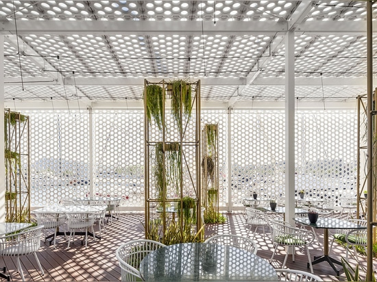 Each of these is elegantly, partially wrapped in a bone-white, perforated screen made of a lightweight, incredibly fine, yet super strong concrete   Read more at http://www.wallpaper.com/architectu...