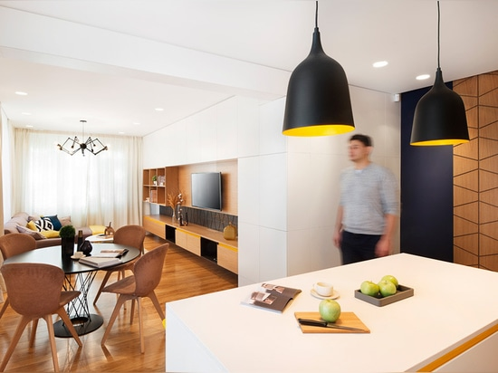 Sunny pops of yellow are found throughout this apartment interior