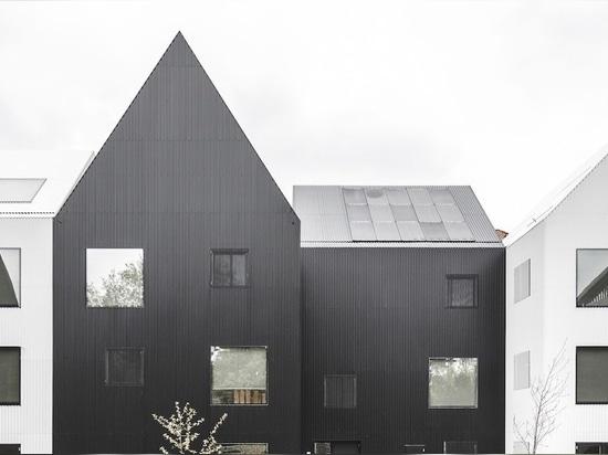 "COBE designs a tiny light-filled ""village"" for children in Copenhagen"