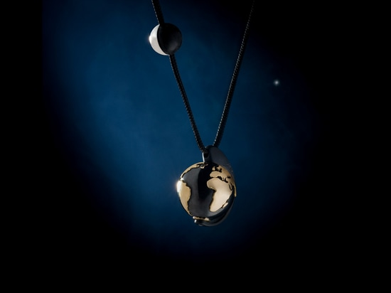 Earth and Moon, 2008, silver & gold, black cord.