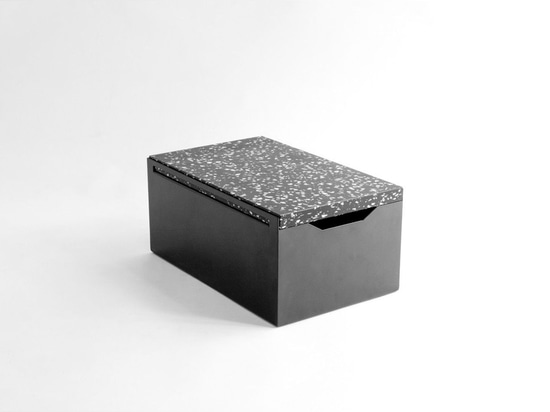 The sleek steel 'Bread Box' uses the 'Black Stracciatella' cutting board as a lid, ensuring contents are kept fresh and your kitchen countertop clean